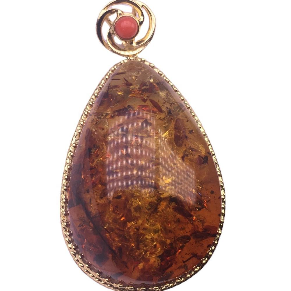 Rare red Baltic amber drop pendant.Amber drop pendant.Gold-plated pendant.