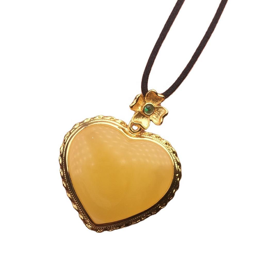 Heart-shaped gold plated amber pendant emeralds pendant