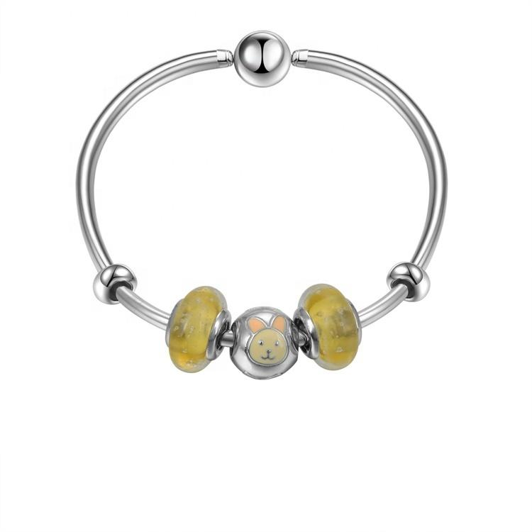 Silver charm bangle for women