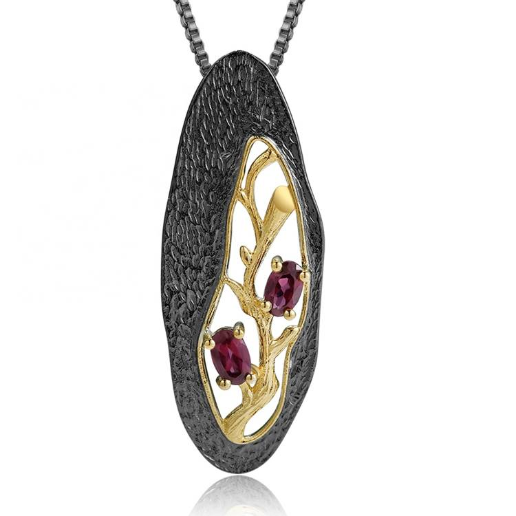 Openwork gold-plated ruby pendant